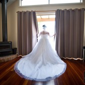 Bride at window of wedding accommodation