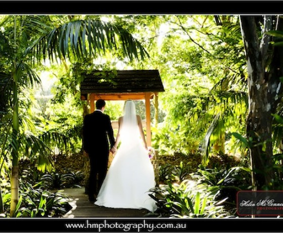 Bride and groom in front of well