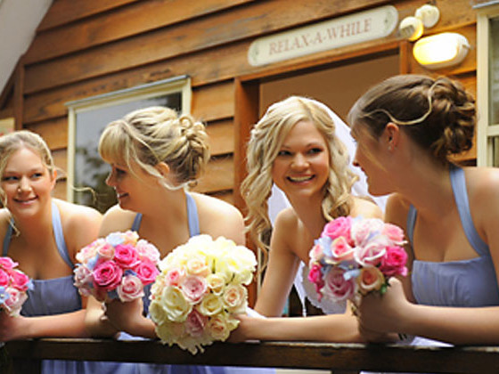 Bride and bridesmaids on deck of wedding accommodation