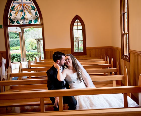 Couple sitting in chapel pews