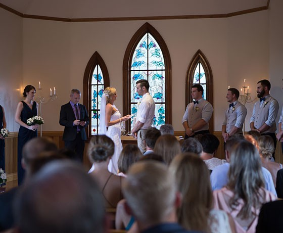Couple taking vows at a ceremony in Tamborine Chapel