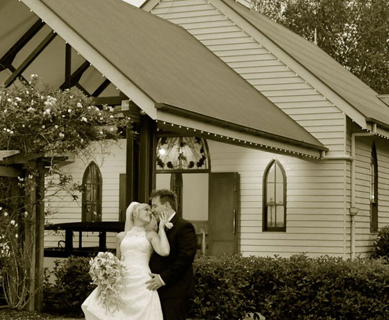 Couple standing out front of Tamborine Chapel